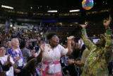 Florence Moss, from Florida, plays with a beach ball in the crowd at the 2008 Democratic National...