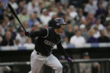 Rockies Kazuo Matsui hits a double off Padres starting pitcher Jake Peavy in the first inning....