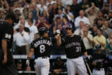 Colorado Rockies pitcher Josh Fogg congratulates Yorvit Torrealba after his homerun in the second...