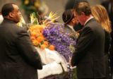 Broncos head coach Mike Shanahan, right, pauses at the casket  at the funeral of Denver Broncos...