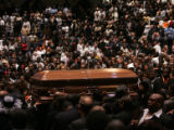 Pallbearers carry the casket of slain  Denver Broncos cornerback Darrent Williams out of the Great...