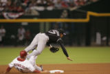 The Colorado Rockies' Kazuo Matsui jumps over Arizona Diamondback Mark Reynolds to turn a double...