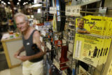Bill Burns walks past a home lead testing kit for sale at the McGuckin Hardware Store in Boulder....