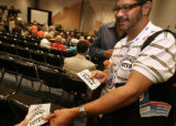 54380 Pedro Rivera, delegate from Pennsylvania, hands out Hispanic voter stickers during the...