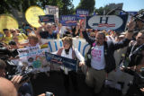 Hillary Clinton supporter Gloria Allred helped lead the Woman's Suffrage March down Colfax Ave. in...