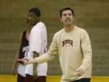 Coach Joe Scott gets on his DU Pioneers during practice at the Richie Center on DU Campus in...
