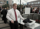 TSA Administrator Kip Hawley, goes through security check point, Monday morning, February 18,...