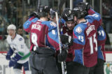 Avs celebrate the winning goal in the 3rd againstVancouver Canucks, March 4, 2008 at the Pepsi...