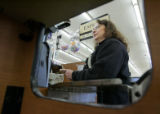Jessie Marin (cq) checks out customers at the Safeway on W. Colfax avenue in Lakewood on March 5,...