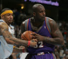 [ JOE197 ] Denver Nuggets Kenyon Martin, left, tries to pull the ball away from Phoenix Suns...