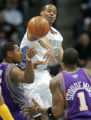 [ JOE371 ] Denver Nuggets Marcus Camby, middle, swats at a pass by Phoenix Suns Broirs Diaw (3) to...