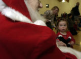 (DENVER, Colo., December 14, 2004) Jenna Hicks,2, was a little in awe at first but warmed up in...