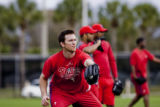 Brad Lidge, pitcher, catches during informal practice before the start of Spring Training at...