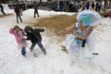 Ice Queen Amy Hessner (cq) of Nederland defends herself from her two children Carmela Hessner, 5,...
