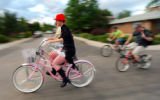 (BOULDER, CO., MAY 27, 2004) A unidentified beach cruiser enthusiast rides along with a group of...