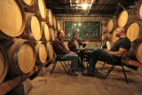 Stephen Menke (cq), an enologist, second from left, talks  to members of the Creekside Cellars,...