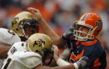 (DENVER, CO., DECEMBER 29, 2004)  University of Colorado's #53, Abraham Wright and #51, Alex...