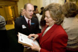 DM0042   Jeanne Labuda, D-Denver, speaks with lobbyist Solomon Malick outside the House Chambers...