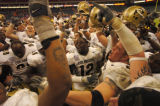 (DENVER, CO., DECEMBER 29, 2004)  Members of the University of Colorado football team sing the...