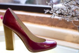 A shoe by Steve Maden sits in the window of the locally popular store Big City Blues on Feb. 16,...