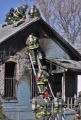 Denver firefighters battle a house fire at 3729 Marion Street Tuesday March 11,2008. No one was...