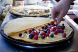 Raspberries, white and milk chocolate chips join the blueberries on a  crepe at Crepes a la Carte...