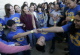 Seniors from Moody High School's Civic Minded Students' Group in Corpus Christi, Texas, cheer on...