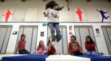 DM0661   Third-grader Elena Barboza jumps and spins as her friends from left, Maria Juarez,...