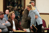 Cindy Busby, right, with the Colorado State Patrol is hugged by  Doug Templeton, Zach Templeton's...