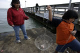 Debbie Rojas (cq), left, watches carefully as her son Ramsey Rojas (cq), 7, makes his way up the...