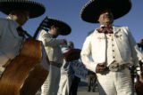 Members of the Mariachi Mexico 85 band prepare to entertain the small crowd waiting for Bill...