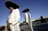 Antonio Perez (cq), left, and Ramero Hernandez (cq), both members of the Mariachi Mexico 85 band, ...