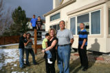 The Fox family stands in the backyard of their house in South Denver. Jana and John have adopted...
