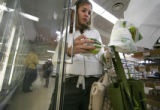 (SR135)  Vitamin Cottage customer Andrea Friedman, 28, of Denver, collects her groceries in her...
