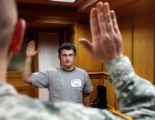 19 year-old Kyle Patrick Kerr (cq) from Arvada, gets sworn-in by Military Major Cort Hunt (cq) as...