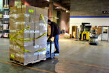 Jefferson County  Schools storage warehouse worker Doug Cone  (cq) moves boxes of  frozen recalled...