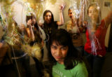 MJM348  As knitting yarn flies through the air, Karla Garcia (cq), 16, center, poses for a...