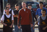John Dues (cq), (at center) the Human Resources manager at West Denver Prep walks with a group of...