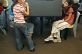 12 year-old Amy Anderson (cq) talks to her mother at the Denver County Jail visitation room as her...