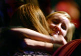 Katy Parr (cq), 18, gets a hug from a well-wisher at a memorial service for her parents and...