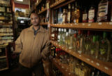 Dawit Beyene (cq), owner of E & S Liquors, 6460 E. Yale Ave, in his store Friday morning March...