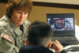 Lakewood Recruiting Station Battalion Sgt. Nancy Alessandri (cq) shows an Army recruiting video to...