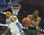 Denver Nugget # 4 Kenyon Martin  (cq) gets by Seattle SuperSonic # 35 Kevin Durant (cq) during...