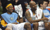 Denver Nugget #3 Allen Iverson (cq) and #12 Chucky Atkins # (cq) all all smiles during a rest in...
