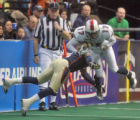Colorado Crush #2 Delvin Hughley (cq) tackles Columbus Destroyer #17 Calvin  Russell (cq)  during...