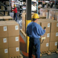 NYT11 - (NYT11) UNDATED -- DEC. 26, 2004 -- RADIO-TAG-TECH -- A warehouse worker uses a radio...