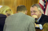 (Golden, Colo., December 14, 2004)  Jefferson County Court Judge Leland Anderson  (right) listens...