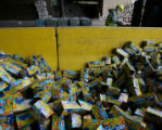 Workers at the Waste Management plant in North Denver load thousands of soda cans to be processed...