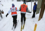 DM0074   Victoria Hulsey, left, and her guide John Ingham, right, get on a lift at Monarch Ski and...