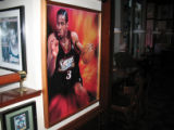 A picture Allen Iverson in a Sixers uniform hangs on a wall Champion's, a sports bar in downtown...